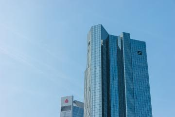 FRANKFURT, GERMANY MARCH, 2017: The Deutsche Bank Twin Towers and the Sparkassen-Finanzgruppe/ German Savings Bank Finance Group skyscraper against blue sky.- Stock Photo or Stock Video of rcfotostock | RC-Photo-Stock