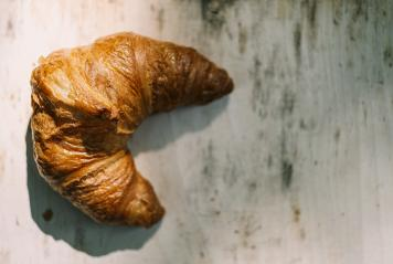 French delicious breakfast . Croissants on wooden background- Stock Photo or Stock Video of rcfotostock | RC-Photo-Stock