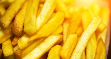 French fries on tracing paper on board on wooden table- Stock Photo or Stock Video of rcfotostock | RC-Photo-Stock