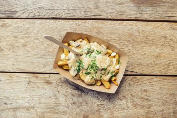 french fries with mushrooms sauce in a paper bowl, on wooden table background- Stock Photo or Stock Video of rcfotostock | RC-Photo-Stock