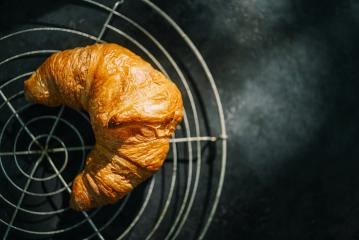 fresh croissants on a bakery gird, top view- Stock Photo or Stock Video of rcfotostock | RC-Photo-Stock