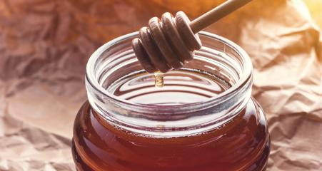 Fresh Honey on a Honey dipper : Stock Photo or Stock Video Download rcfotostock photos, images and assets rcfotostock | RC-Photo-Stock.: