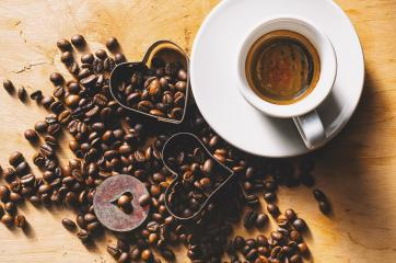 Fresh tasty espresso cup of hot coffee with coffee beans on a wooden background- Stock Photo or Stock Video of rcfotostock | RC-Photo-Stock