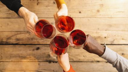 Friends hands toasting red wine glass and having fun cheering with winetasting - Young people enjoying time together at a wine bar - Youth and friendship concept, Flat-lay top view shot- Stock Photo or Stock Video of rcfotostock | RC-Photo-Stock
