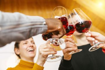 Friends hands toasting red wine glass and having fun cheering with winetasting - Young people enjoying time together at home - Youth and friendship concept- Stock Photo or Stock Video of rcfotostock | RC-Photo-Stock