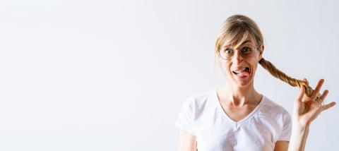Funny blond woman in white shirt posing on gray background, Having fun and hold hair tail or Braid and showing tongue. People lifestyle concept, with copy space for individual text- Stock Photo or Stock Video of rcfotostock   RC-Photo-Stock