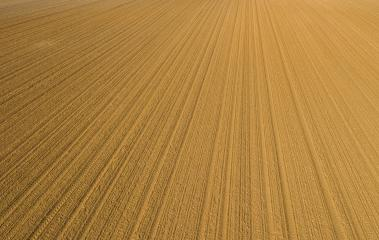 Furrows row pattern in a plowed field prepared for planting crops in spring time, drone point of view shot- Stock Photo or Stock Video of rcfotostock | RC-Photo-Stock