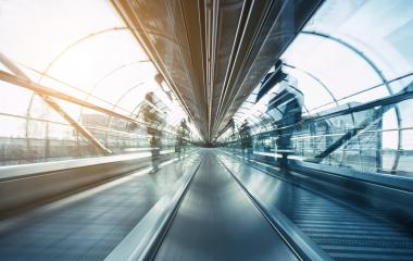futuristic airport skywalk with blurred passengers- Stock Photo or Stock Video of rcfotostock | RC-Photo-Stock