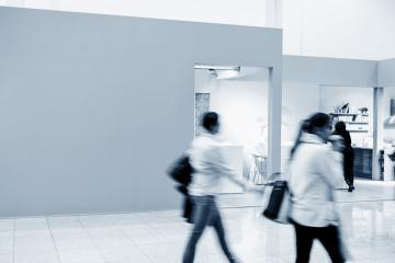 Futuristic trade fair booth with blurred people - business concept image- Stock Photo or Stock Video of rcfotostock | RC-Photo-Stock
