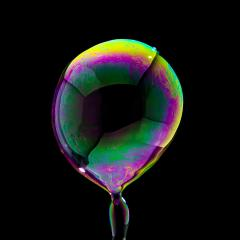 fyling Soap Bubble in colorful colors on black background- Stock Photo or Stock Video of rcfotostock | RC-Photo-Stock