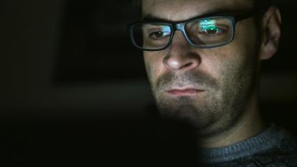 Gambling addicted man with glasses in front of online casino slot machine on laptop computer at night - loosing his money. Dramatic low light grain shot.- Stock Photo or Stock Video of rcfotostock   RC-Photo-Stock
