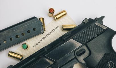 Gas pistol with cartridges- Stock Photo or Stock Video of rcfotostock | RC-Photo-Stock