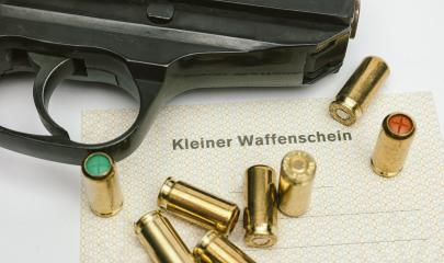 gas pistol with cartridges and (Kleiner Waffenschein) : Stock Photo or Stock Video Download rcfotostock photos, images and assets rcfotostock | RC-Photo-Stock.: