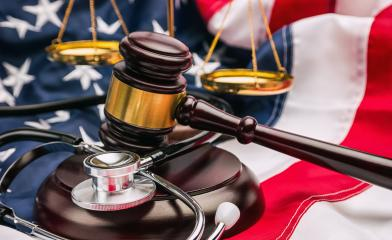 Gavel, stethoscope and scale on national flag of USA - medicine concept image- Stock Photo or Stock Video of rcfotostock | RC-Photo-Stock
