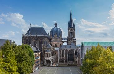German cathedral in Aachen during spring with yellow green leafs at trees with blue cloudy sky : Stock Photo or Stock Video Download rcfotostock photos, images and assets rcfotostock | RC-Photo-Stock.: