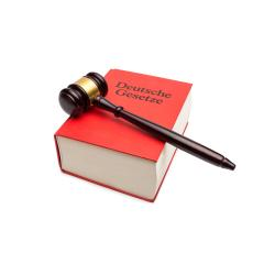 German law book (Deutsche gesetzte) with Gavel isolated on white backgorund- Stock Photo or Stock Video of rcfotostock | RC-Photo-Stock