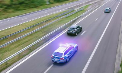 German police car on hightway driving fast : Stock Photo or Stock Video Download rcfotostock photos, images and assets rcfotostock | RC-Photo-Stock.: