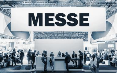 German text Messe, translate Trade Show. Crowd of people at a trade show booth with a banner and text : Stock Photo or Stock Video Download rcfotostock photos, images and assets rcfotostock | RC-Photo-Stock.: