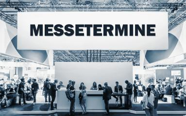 German text Messetermine, translate Trade Show Events. Crowd of people at a trade show booth with a banner and text : Stock Photo or Stock Video Download rcfotostock photos, images and assets rcfotostock | RC-Photo-Stock.: