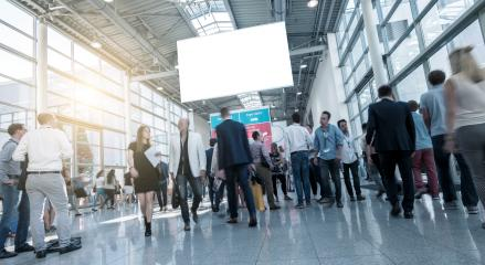 German Tradeshow Visitors at a modern hall- Stock Photo or Stock Video of rcfotostock | RC-Photo-Stock