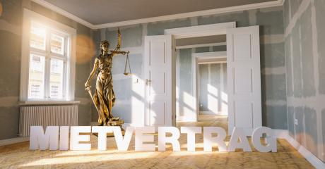 German word Mietvertrag (rental contract) in a apartment with The Statue of Justice - lady justice or Iustitia / Justitia the Roman goddess of Justic as a concept image - Stock Photo or Stock Video of rcfotostock | RC-Photo-Stock