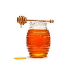 Glass jar full of honey wooden honey dipper : Stock Photo or Stock Video Download rcfotostock photos, images and assets rcfotostock | RC-Photo-Stock.: