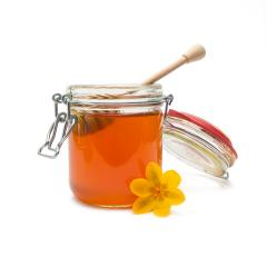 Glass jar of bio honey with honey dipper- Stock Photo or Stock Video of rcfotostock | RC-Photo-Stock