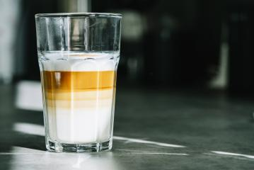glass of latte on a dark table background. copyspace for your individual text.- Stock Photo or Stock Video of rcfotostock | RC-Photo-Stock