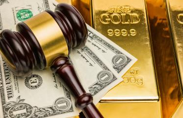gold bars with american dollar and judge gavel- Stock Photo or Stock Video of rcfotostock | RC-Photo-Stock