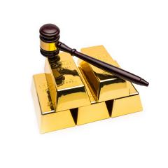 gold bars with wooden auction gavel on white background : Stock Photo or Stock Video Download rcfotostock photos, images and assets rcfotostock | RC-Photo-Stock.: