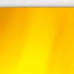 Golden Beer with foam and condensation drops : Stock Photo or Stock Video Download rcfotostock photos, images and assets rcfotostock | RC-Photo-Stock.: