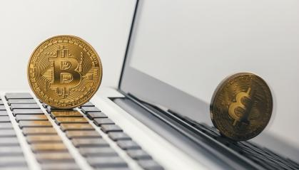 Golden Bitcoin - New virtual money on notebook- Stock Photo or Stock Video of rcfotostock | RC-Photo-Stock