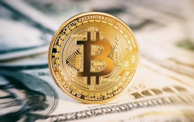 golden bitcoin coin on us dollars close up- Stock Photo or Stock Video of rcfotostock | RC-Photo-Stock