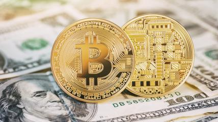 golden bitcoin coins on us dollars notes- Stock Photo or Stock Video of rcfotostock | RC-Photo-Stock
