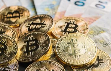 golden bitcoin lying on top of Euro banknotes - Stock Photo or Stock Video of rcfotostock | RC-Photo-Stock