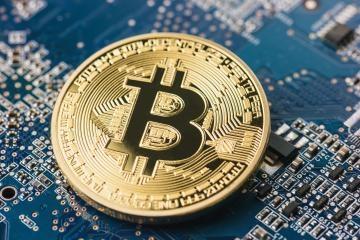 Golden bitcoin on mainboard surface- Stock Photo or Stock Video of rcfotostock | RC-Photo-Stock