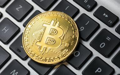 Golden Bitcoin on notebook- Stock Photo or Stock Video of rcfotostock | RC-Photo-Stock