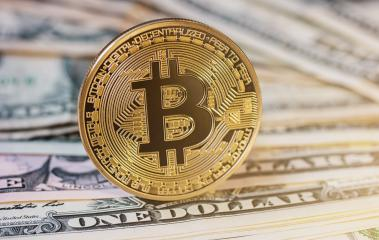Golden Bitcoin on US dollar note. Electronic money exchange concept- Stock Photo or Stock Video of rcfotostock | RC-Photo-Stock