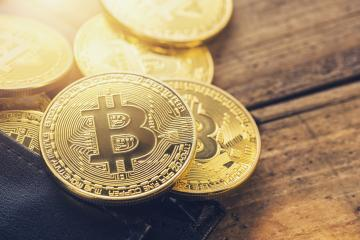 Golden Bitcoins - New virtual money in a wallet- Stock Photo or Stock Video of rcfotostock | RC-Photo-Stock