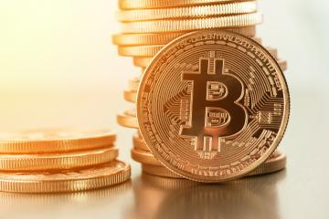 Golden Bitcoins on a gold background .Photo (new virtual money )- Stock Photo or Stock Video of rcfotostock | RC-Photo-Stock