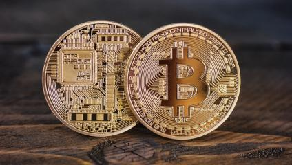 Golden Bitcoins on a wooden table- Stock Photo or Stock Video of rcfotostock | RC-Photo-Stock