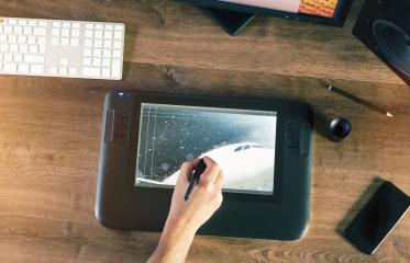 Graphic Designer working with digital Drawing tablet and Pen : Stock Photo or Stock Video Download rcfotostock photos, images and assets rcfotostock | RC-Photo-Stock.: