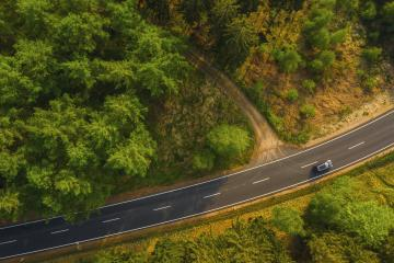 Green forest aerial drone view. Road with car in forest from above. Transportation background.- Stock Photo or Stock Video of rcfotostock | RC-Photo-Stock