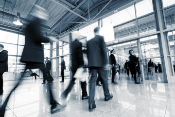 group of business people in the entrance of a International Trade Fair- Stock Photo or Stock Video of rcfotostock | RC-Photo-Stock