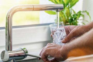 Hand holding a glass of water poured from the kitchen faucet : Stock Photo or Stock Video Download rcfotostock photos, images and assets rcfotostock | RC-Photo-Stock.: