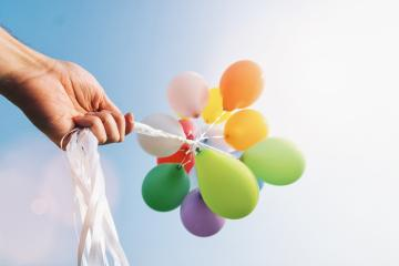 hand holding Colorful balloons : Stock Photo or Stock Video Download rcfotostock photos, images and assets rcfotostock | RC-Photo-Stock.: