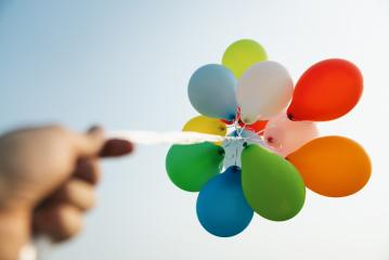 hand holding Colorful balloons at a funfair : Stock Photo or Stock Video Download rcfotostock photos, images and assets rcfotostock | RC-Photo-Stock.: