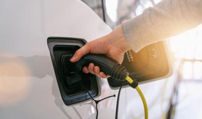 Hand holding Electric car charger. Power supply electric car charging for electric car technology transportation in the future. : Stock Photo or Stock Video Download rcfotostock photos, images and assets rcfotostock | RC-Photo-Stock.: