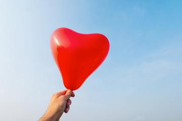 hand holding Heart shape balloon : Stock Photo or Stock Video Download rcfotostock photos, images and assets rcfotostock | RC-Photo-Stock.: