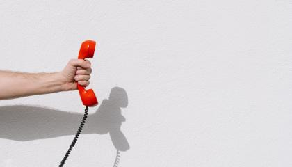 hand holding Red telephone receiver with copy space : Stock Photo or Stock Video Download rcfotostock photos, images and assets rcfotostock | RC-Photo-Stock.: